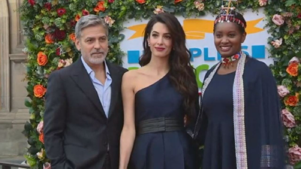 The Clooneys arrive in Edinburgh to collect charity award
