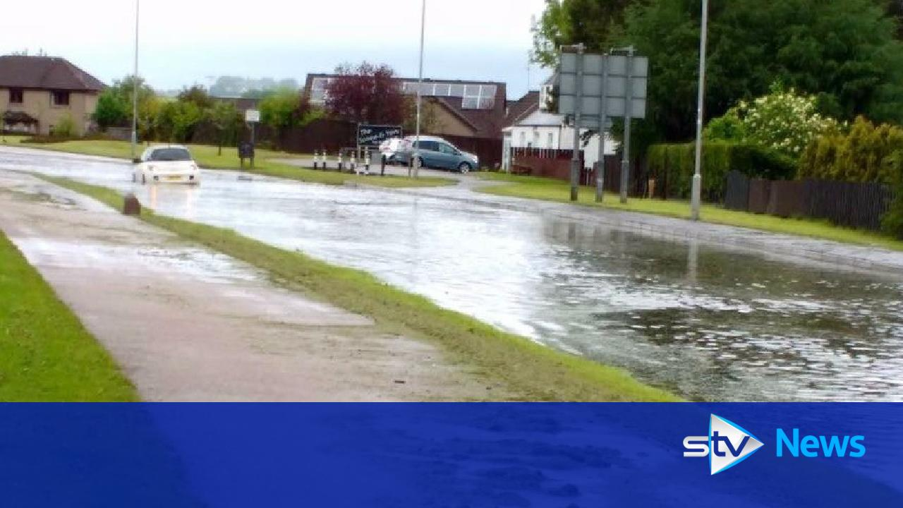 flash flooding in town as rest of scotland basks in summer sun