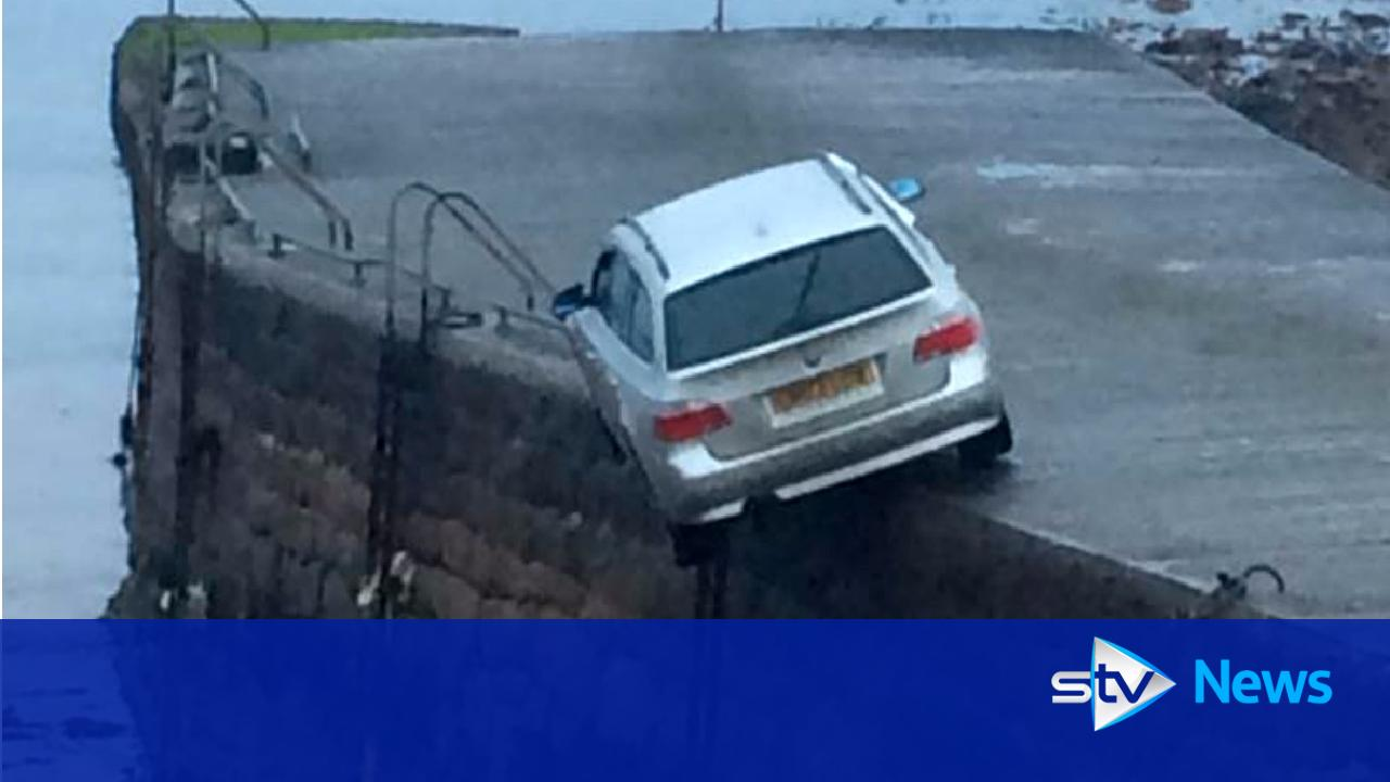 Bmw North Haven >> BMW found abandoned and dangling precariously off edge of pier