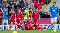 Aberdeen players celebrate after James Maddison's late winner.