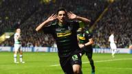 Can you hear me? Lars Stindl celebrates the opening goal.