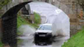 Generic of flooding car floods rain rainy weather roads. Quality image.
