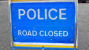 Quality shot of police road closed sign in Edinburgh.
