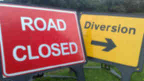 Closure: Police working to clear the road.