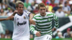 Celtic's Kris Commons (right) up against Real Madrid's Fabio Coentrao in August 2012.