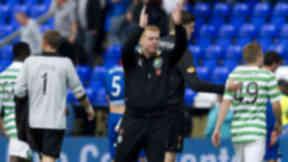 Celtic manager Neil Lennon applauds the traveling fans at full-time.