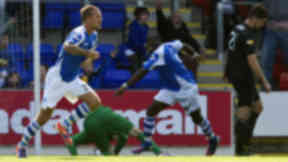 St Johnstone's Rowan Vine (left) wheels away to celebrate his winning goal