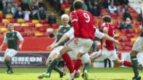 Aberdeen's Gavin Rae (right) charges in to score the winning goal from close range