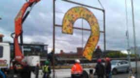 The question mark sculpture being erected at the Finneston Crane by artist Alec Galloway in tribute to the later George Wyllie.