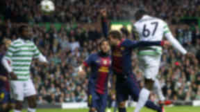 Celtic star Victor Wanyama (67) rises high above the Barcelona defence to open the scoring with a header