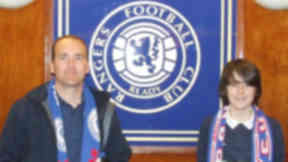 DO NOT USE Walter Barrie and his son Callum at Ibrox stadium, the home of Rangers FC, who they support.