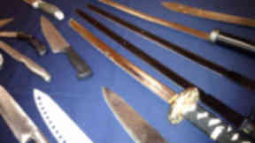 Knives, samurai sword and other bladed weapons seized by police. November 2012