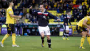 Dundee forward Steven Milne wheels away to celebrate his opener.