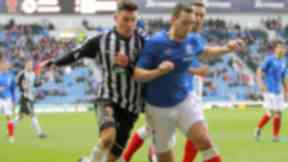 Ibrox Tussle: Stuart Leslie tries to break free from the attentions of Lee Wallace.