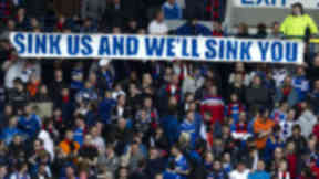 """Rangers fans with """"sink us and we'll sink you"""" banner."""