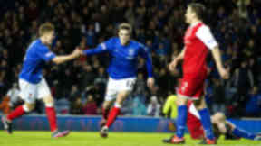 Andrew Little (centre) races off to celebrate after firing home Rangers' second goal of the game.