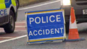 Crash: Two people were trapped in an upturned vehicle.