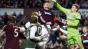 Keeper Ben Williams (1) is forced to come off his line to clear the danger presented by Hearts' Marius Zaliukas