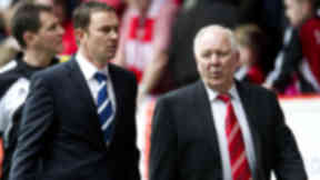 Aberdeen manager Craig Brown (right) and Ross County counterpart Derek Adams make their way to the touchline.