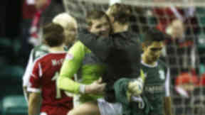 Leigh Griffiths congratulates goalkeeper Ben Williams after the final whistle.