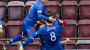 ICT's Gary Warren (hidden) is surrounded by delighted team-mates after giving his side a 3-2 lead