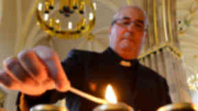 Philip Tartaglia: The archbishop of Glasgow leads the mass.