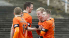 Gary Mackay-Stevens is congratulated by teammates for the winner.