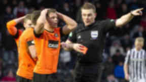 Referee John Beaton shows the red card to Dundee Utd's John Rankin (left)