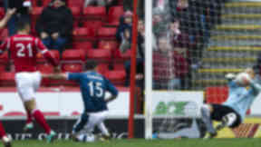 Aberdeen's Josh Magennis' (left) shot is saves by goalkeeper Darren Randolph.