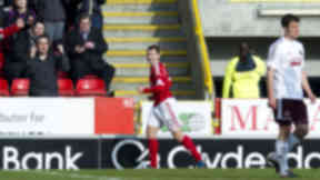 Niall McGinn scores for Aberdeen against Hearts.