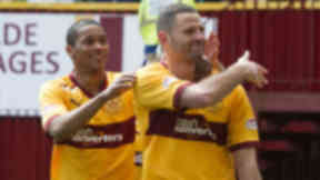 Motherwell striker Michael Higdon (right) is hailed by team-mate Chris Humphrey after scoring from the penalty spot to make it 2-1 to the home side
