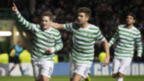 Kris Commons celebrating with Charlie Mulgrew in early 2013.