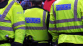 Generic police officer photo. Three officers, two with backs to camera. Police generic photo. Police officer, policeman, Police Scotland