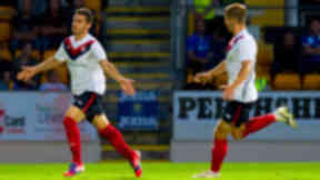 Milos Rnic (left) rushes to celebrate his strike which levels the tie in the second half