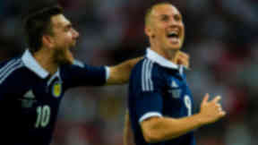 Scotland's Kenny Miller celebrates scoring the second goal of the match for the visitors.