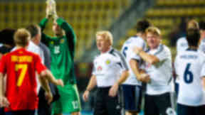Scotland manager Gordon Strachan congratulates his players at full-time