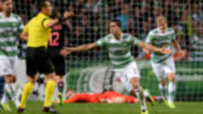 Celtic's Beram Kayal wheels away to celebrate after scoring his side's second