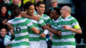 Virgil Van Dijk (2nd left) is hailed after scoring his first goal for Celtic