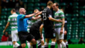 Referee Bobby Madden rushes to seperate Hibernian's Jordan Forster and Anthony Stokes as tempers flare.