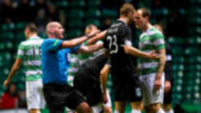 Referee Bobby Madden (left) rushes to separate Hibernian's Jordan Forster and Anthony Stokes as tempers flare.