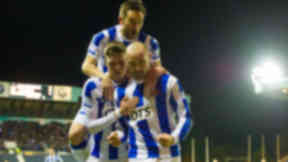 Kilmarnock's Kris Boyd (right) is mobbed by team-mates Barry Nicholson (top) and Robbie Muirhead after scoring a late winner
