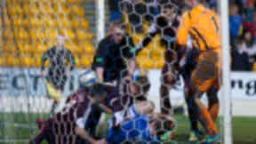 Referee Brian Colvin (top left) is forced to step in as St Johnstone's Frazer Wright (bottom) tries to hold up play after Hearts' Sam Nicholson (not pictured) pulls a goal back for his side.