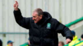 Hibernian manager Terry Butcher tries to get a message out to his players.