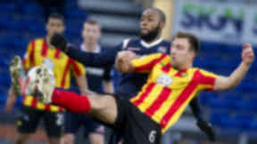 Ross County's Yoann Arquin goes up against Conrad Balatoni of Partick Thistle, March 2014.