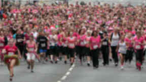 Thousands of women Race for Life through Glasgow.