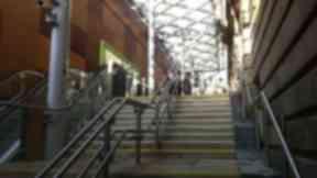 Waverley station: Woman was tripped near escalator.