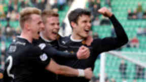 Motherwell's John Sutton (right) is mobbed by team-mates after scoring a late equiliser for his side.