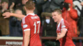 Aberdeen's Jonny Hayes celebrates his second goal of the game with Adam Rooney (left)