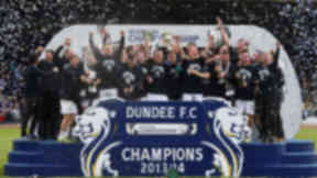 Going up: Scottish Championship winners Dundee celebrate with the trophy.