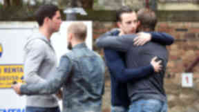 Farewell: Club captain Danny Wilson hugs his former teammates as Ryan Stevenson, Jamie Hamill and Dylan McGowan depart.